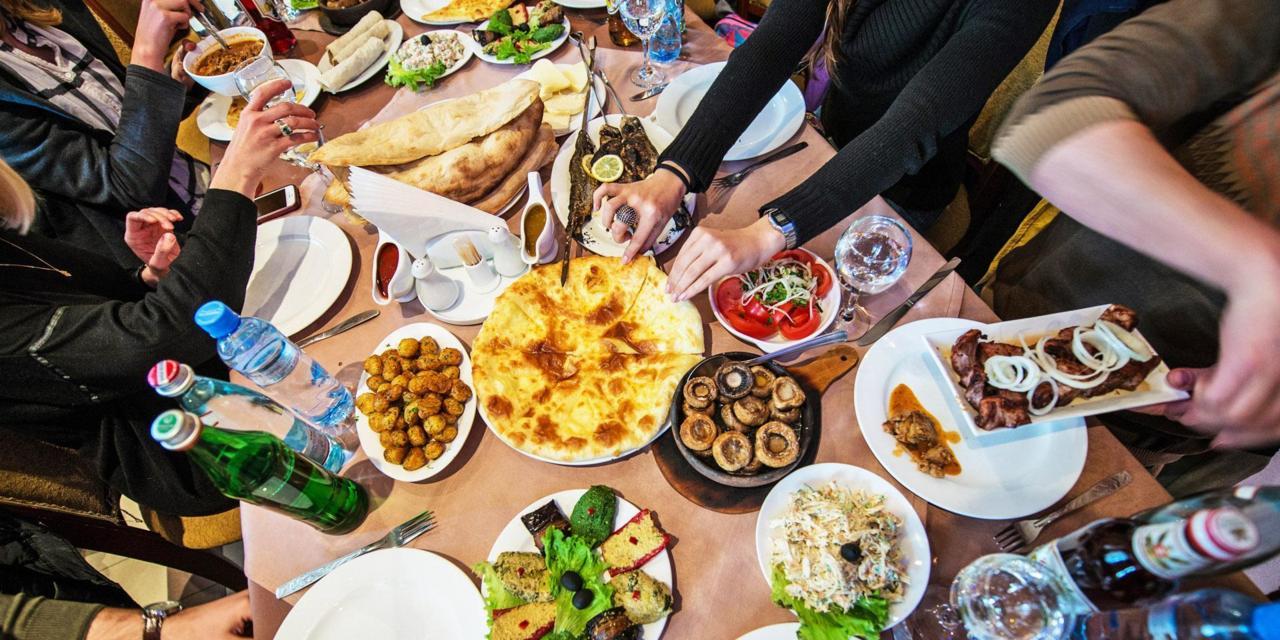ET8A3T Georgian traditional food like Imeretian khachapuri, roasted mushrooms, Pkhali salad, roasted fshes and potatoes and lamb kebab
